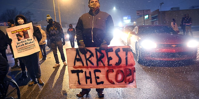 <br> Activists show support for Jacob Blake Jr. during a vigil near the Kenosha County Courthouse on Jan. 4, 2021, in Kenosha, Wis. (Getty Images)