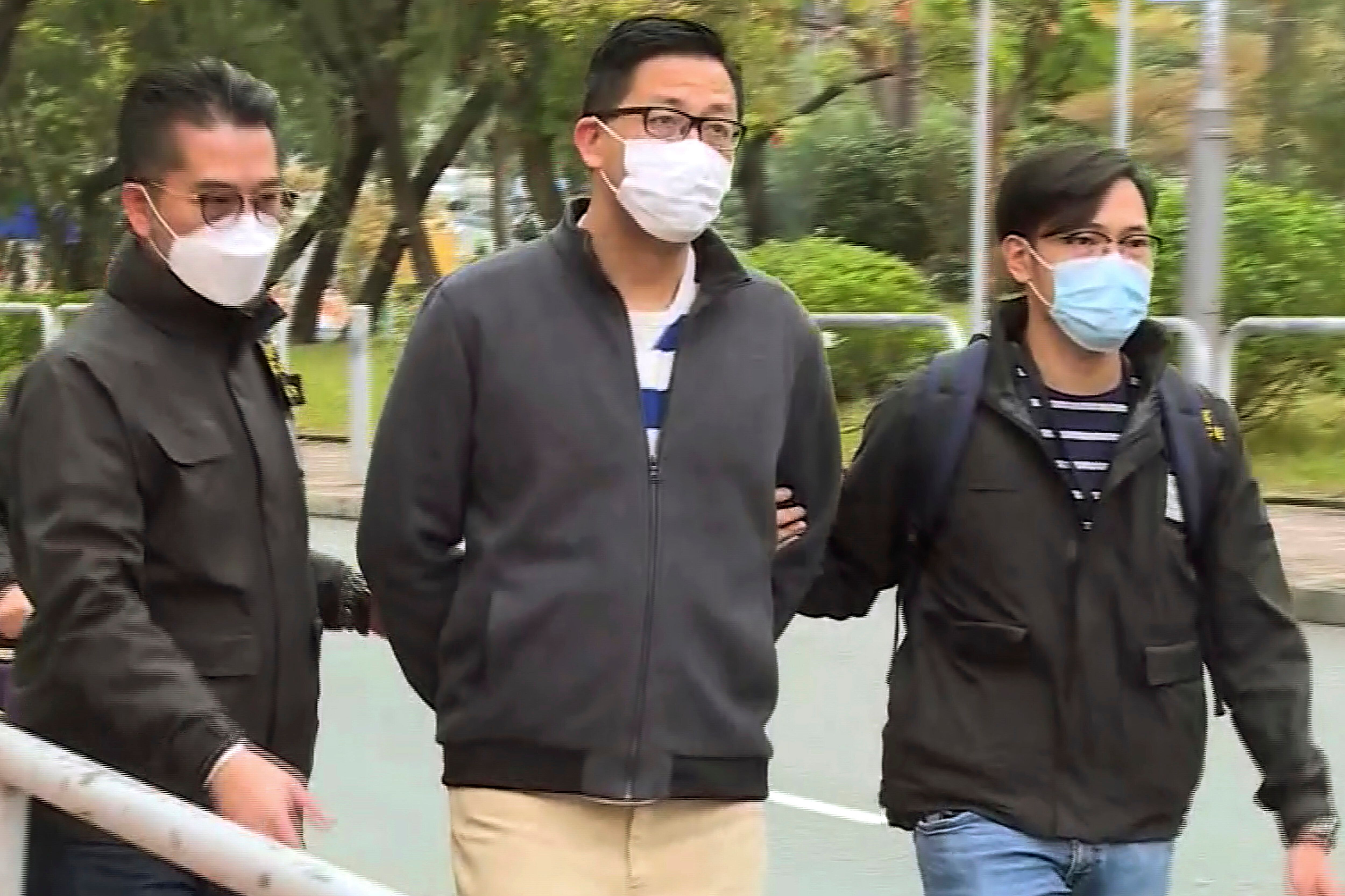 In this image taken from a video, Hong Kong's Democratic Party member and former lawmaker Lam Cheuk-ting, center, is arrested