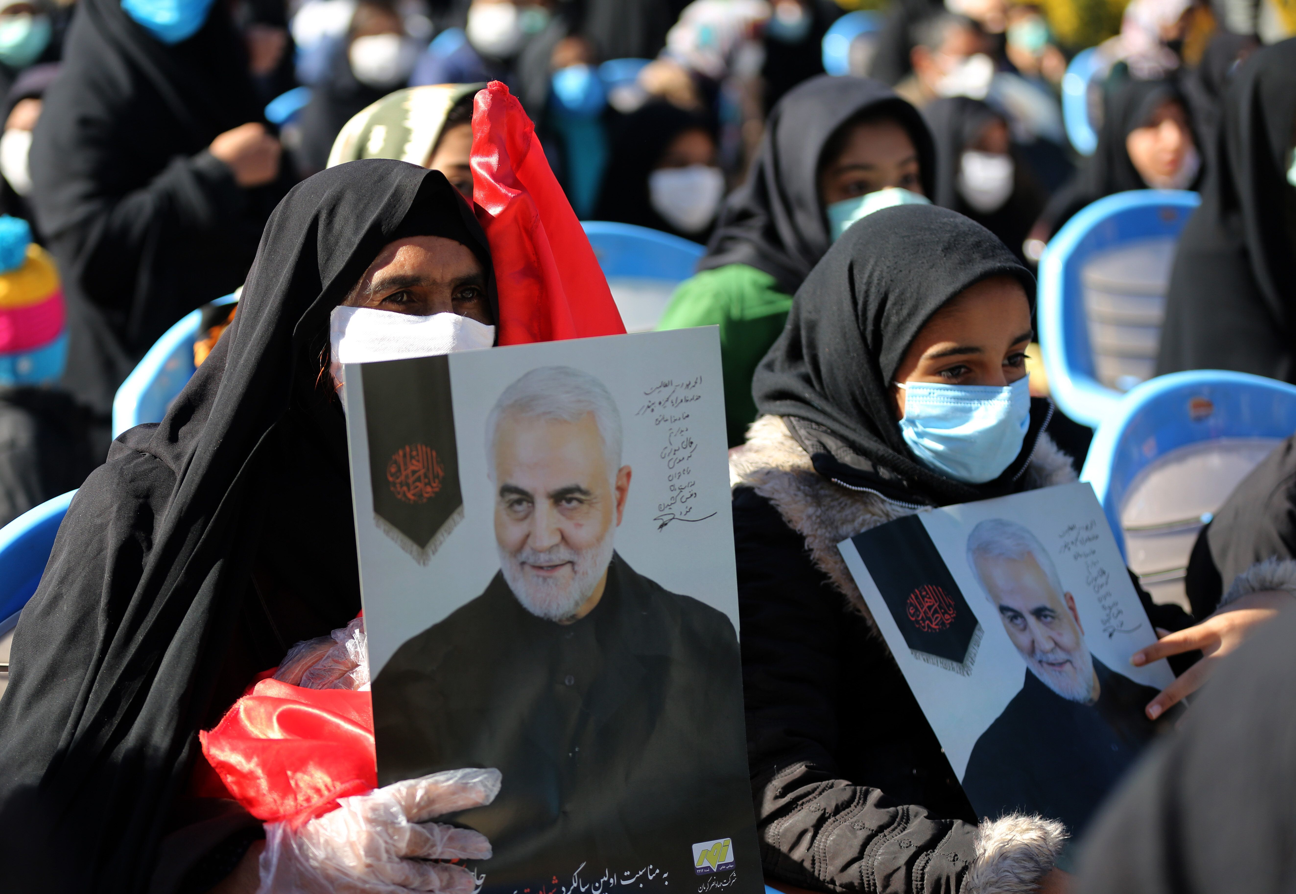 People attend a ceremony in Iran on Saturday to commemorate the first anniversary of the death of Qassem Soleimani.