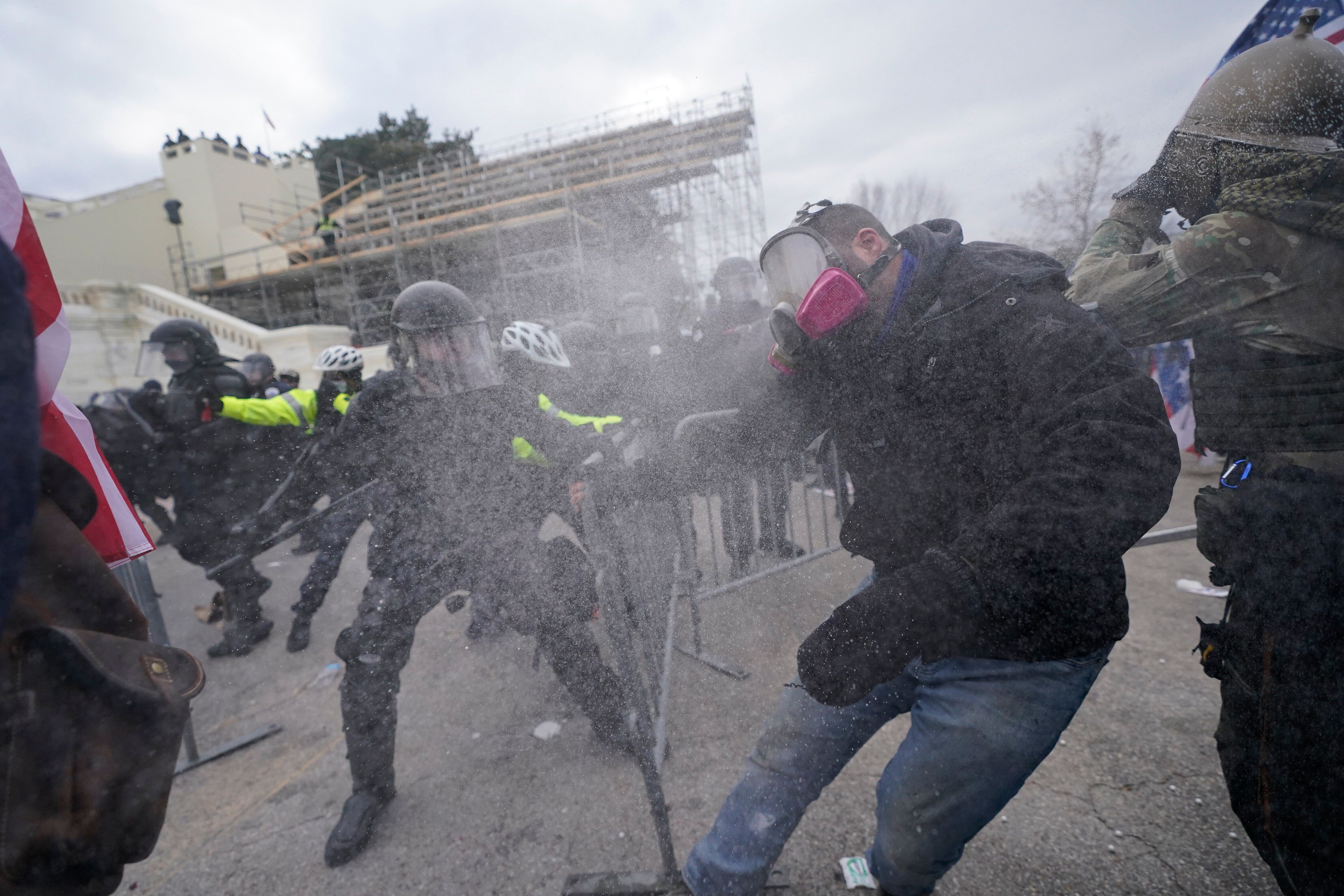 Trump supporters try to break through a police barrier, Wednesday, Jan. 6, at the Capitol in Washington, D.C.