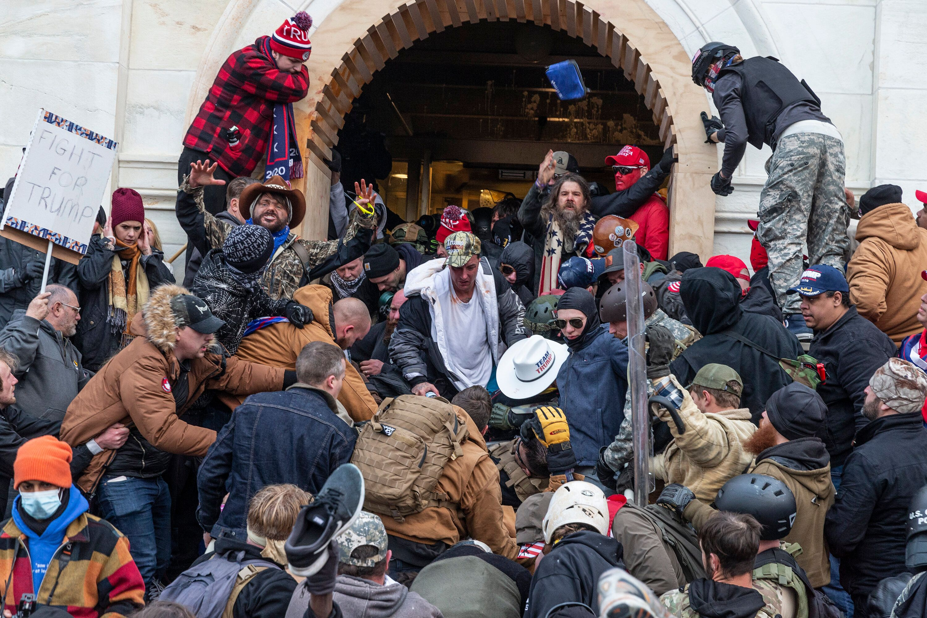 Rioters clash with police as they try to enter the Capitol on Jan. 6.
