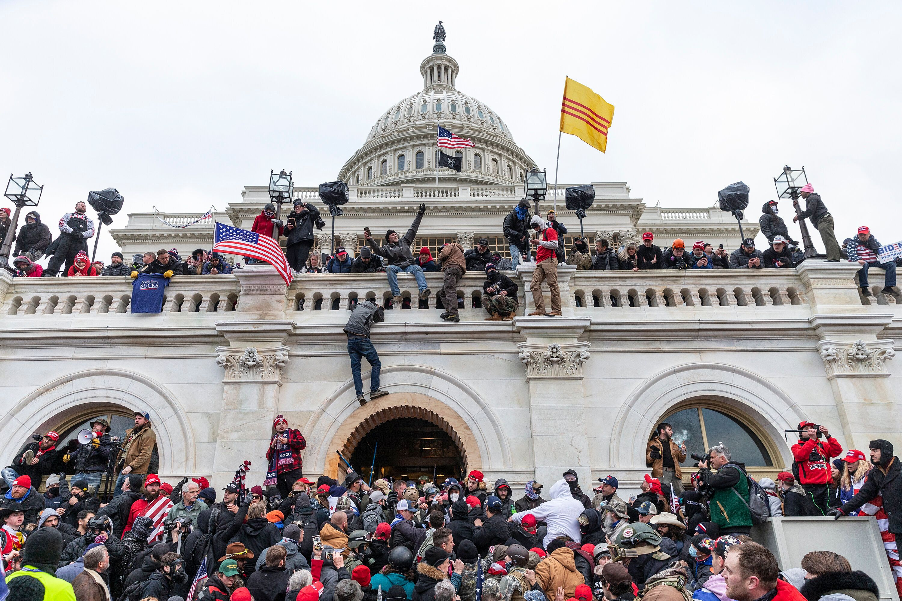 Rioters climbed on and defaced the Capitol as hundreds of insurrectionists breached the home of the legislative branch in an