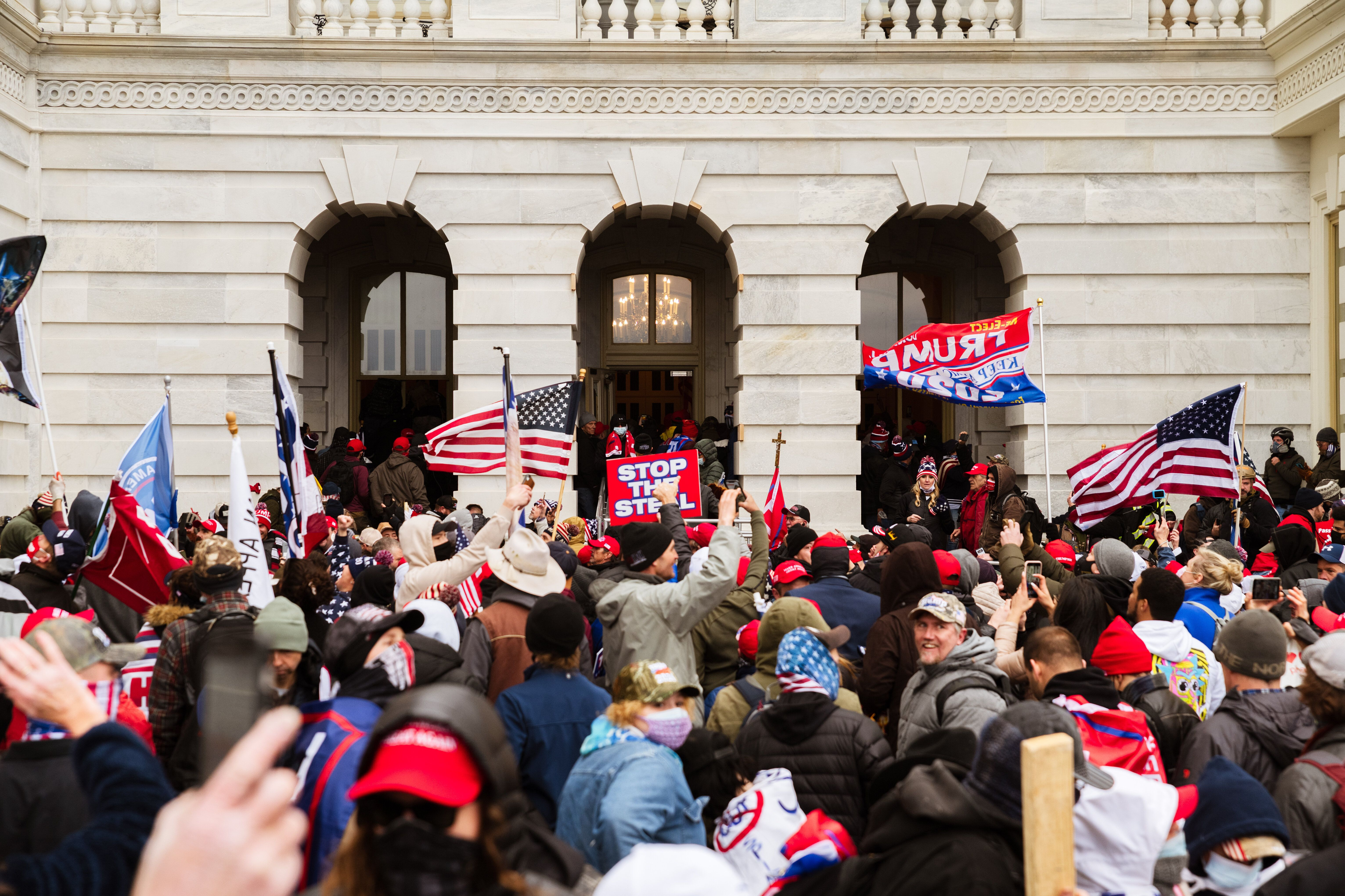 A pro-Trump mob floods into the Capitol Building after breaking into it on Jan. 6.