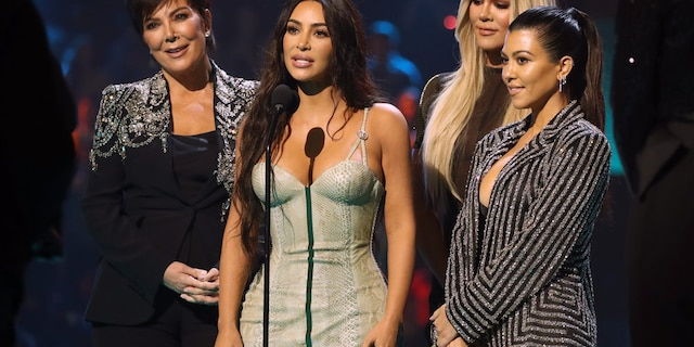 Pictured: (l-r) Kris Jenner, Kim Kardashian, Khloé Kardashian, and Kourtney Kardashian accept The Reality Show of 2019 for 'Keeping Up with the Kardashians' during the 2019 E! People's Choice Awards held at the Barker Hangar on November 10, 2019. The E! series is ending in early 2021 after 14 years and 20 seasons.