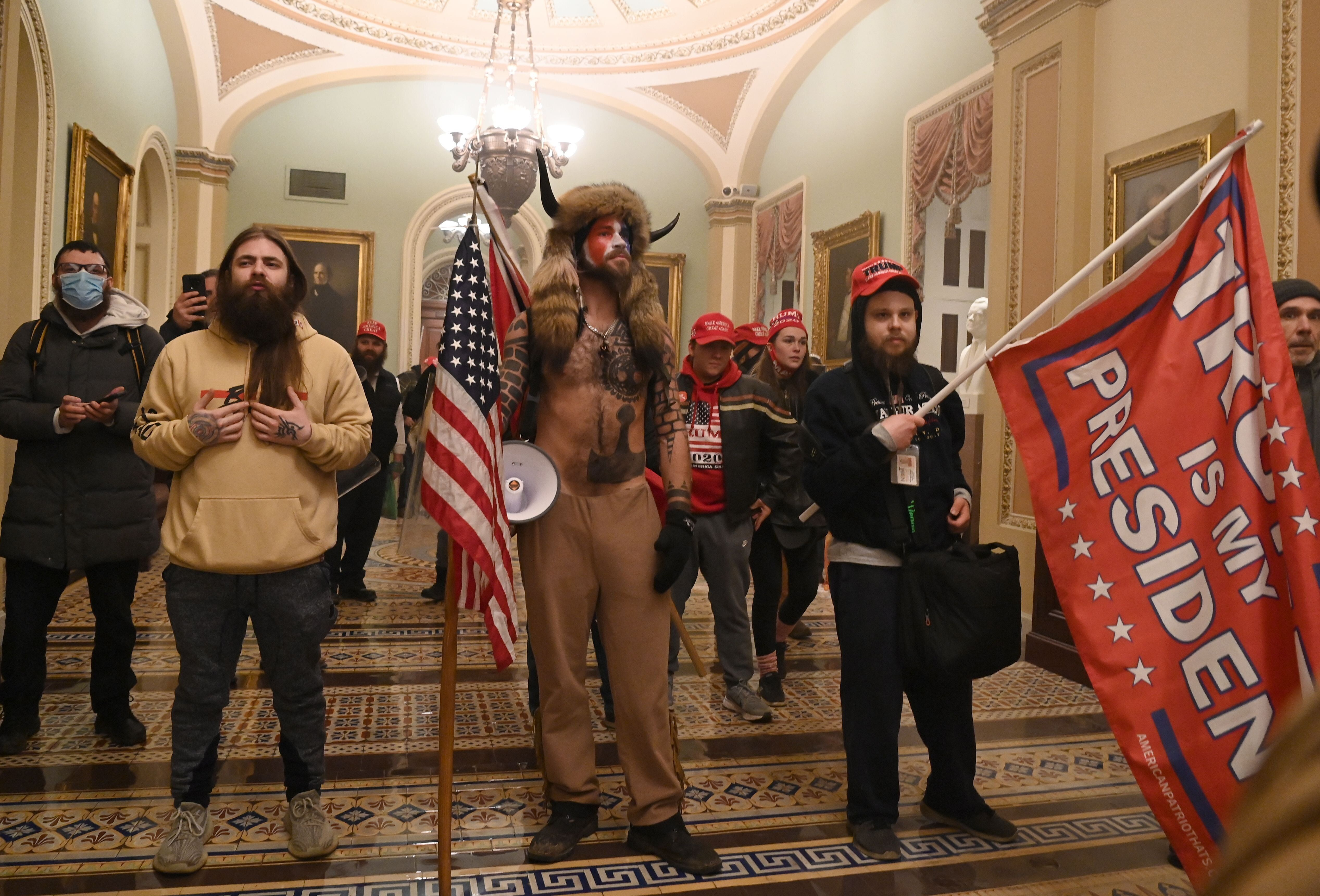 Trump supporters storm through the Capitol on Wednesday after breaching security and breaking through windows and doors while