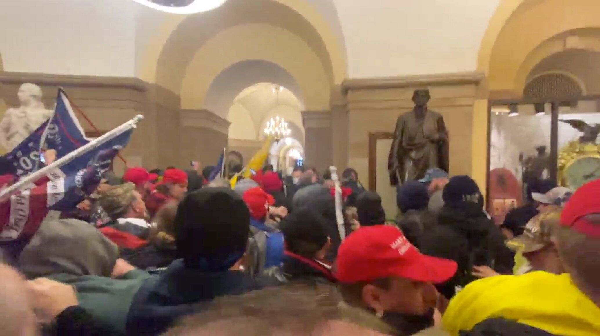 Supporters of President Donald Trump storm the Capitol building in Washington, U.S., January 6, 2021 in this screen grab obta