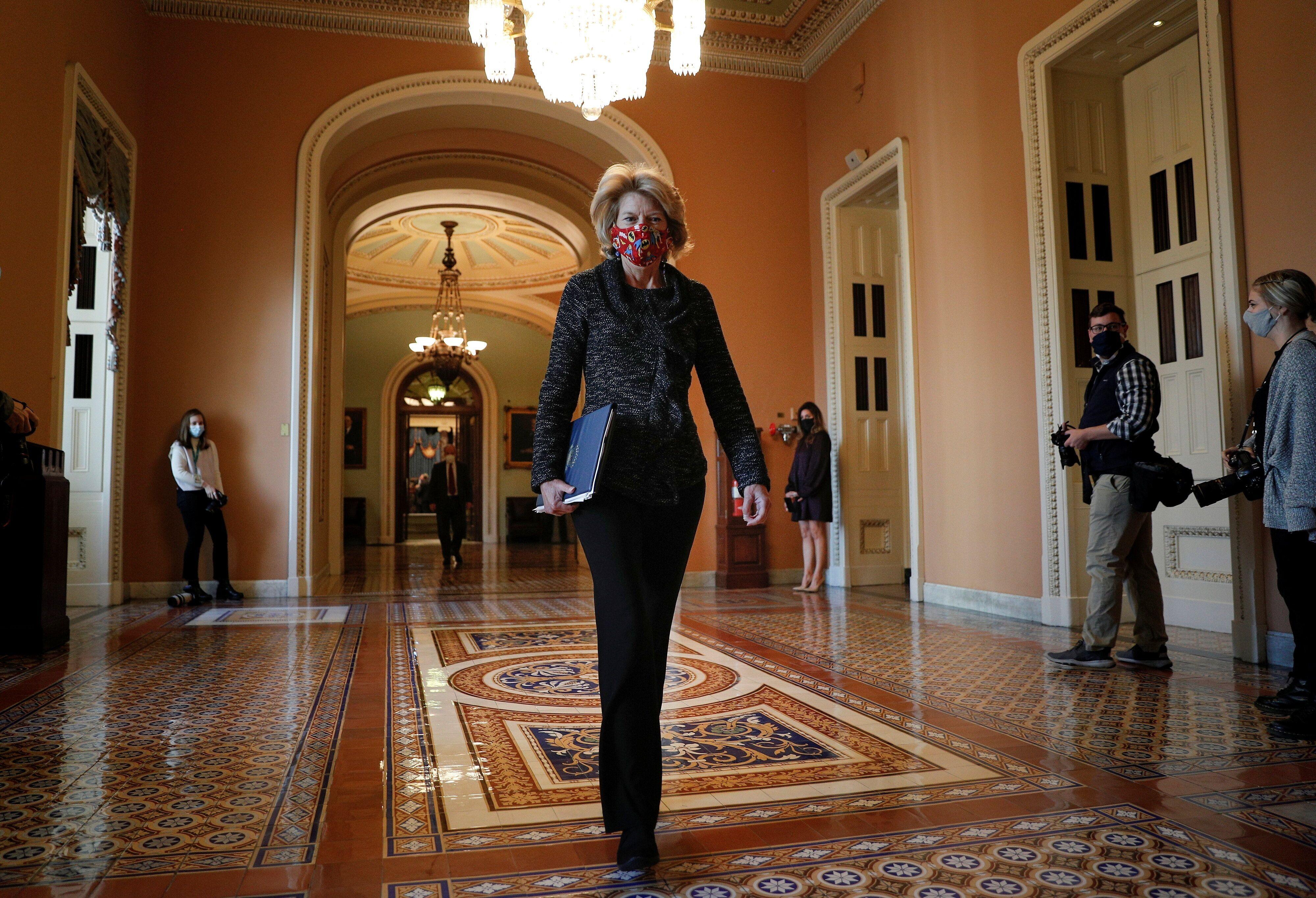 Senator Lisa Murkowski (R-AK) walks to the office of the Majority Leader from the Senate Chamber ahead of a meeting with Sena