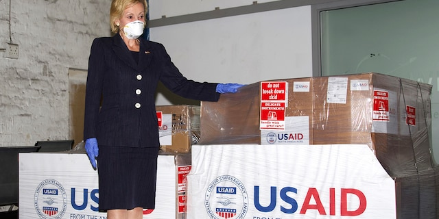 U.S. Ambassador to South Africa Lana Marks posing with ventilators donated by the U.S. Government at OR Tambo Airport Johannesburg on May 11, 2020. Marks, on Monday, Jan. 11, 2021, said she spent 10 days in a South African hospital's intensive care unit with COVID-19 and is now recuperating at her residence. (Leon Kgoedi/United States Embassy South Africa via AP)