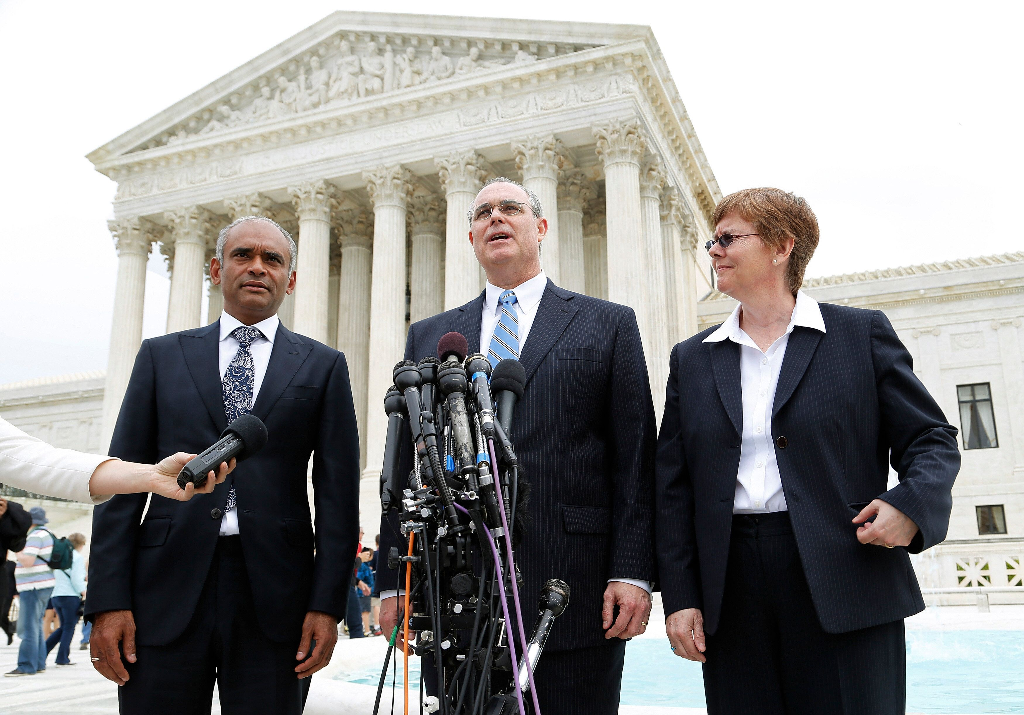 David Frederick, pictured in the center, seen in 2008 outside the Supreme Court, where he was arguing a case on behalf of the