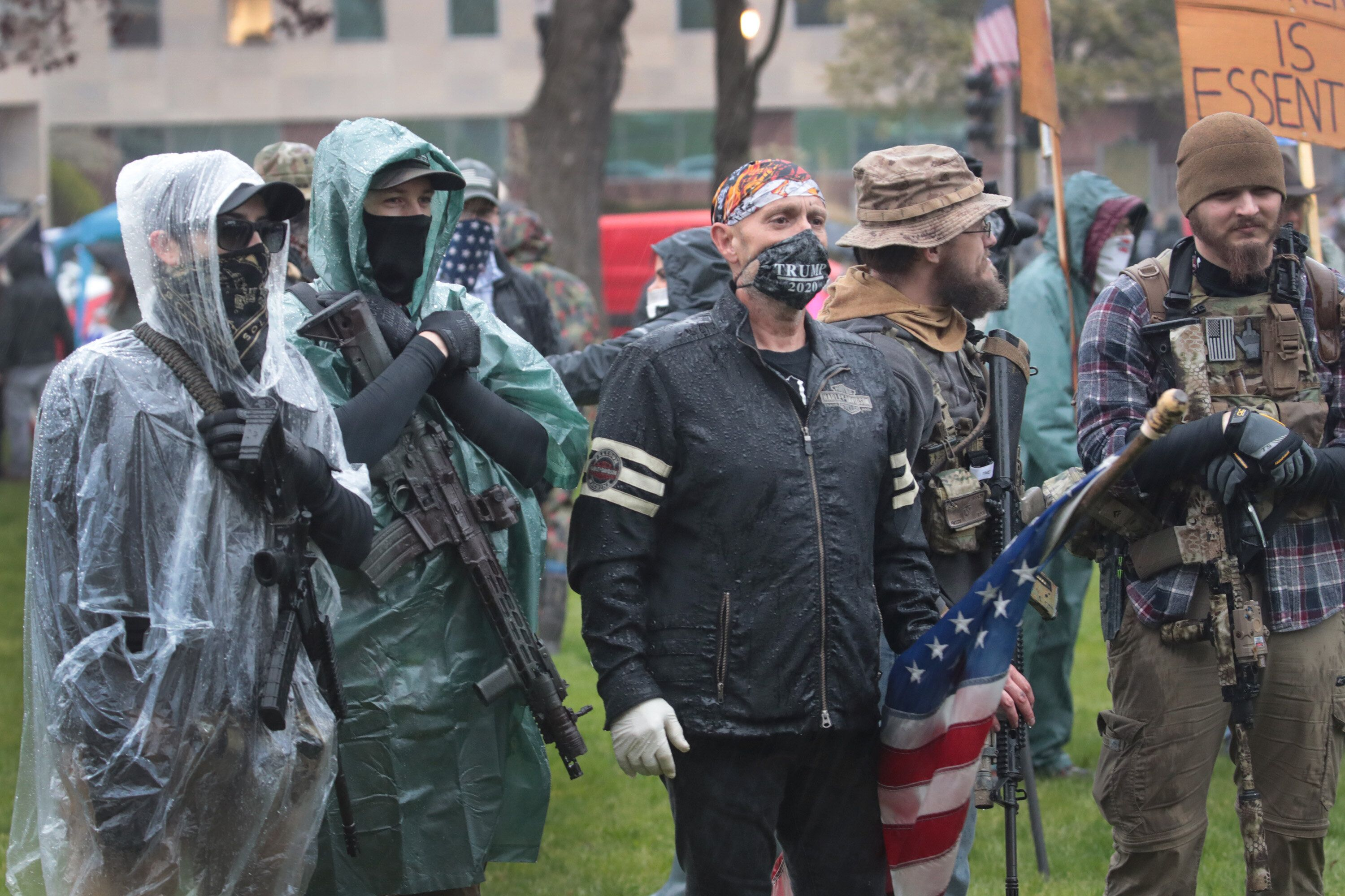 Gun-toting protesters rallied outside the Michigan state capitol this spring to demonstrate against Gov. Gretchen Whitmer's C