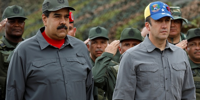 Venezuela's President Nicolas Maduro, Venezuela's Vice President Tareck El Aissami and Cilia Flores take part in a military exercise at Fuerte Tiuna military base in Caracas, Venezuela February 24, 2018. REUTERS/Marco Bello - RC17D57B06D0