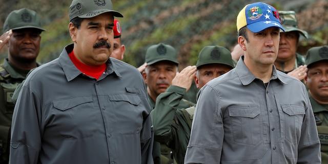 Venezuela's President Nicolas Maduro, Venezuela's Vice President Tareck El Aissami and Cilia Flores take part in a military exercise at Fuerte Tiuna military base in Caracas, Venezuela February 24, 2018. REUTERS/Marco Bello - RC17D57B06D0