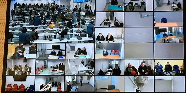 A screen anchored to the ceiling shows the participants following the first hearing of a maxi-trial against more than 300 defendants of the 'ndrangheta crime syndicate in a specially constructed bunker near the Calabrian town of Lamezia Terme, southern Italy, Wednesday, Jan. 13, 2021. (AP Photo/Gianfranco Stara)