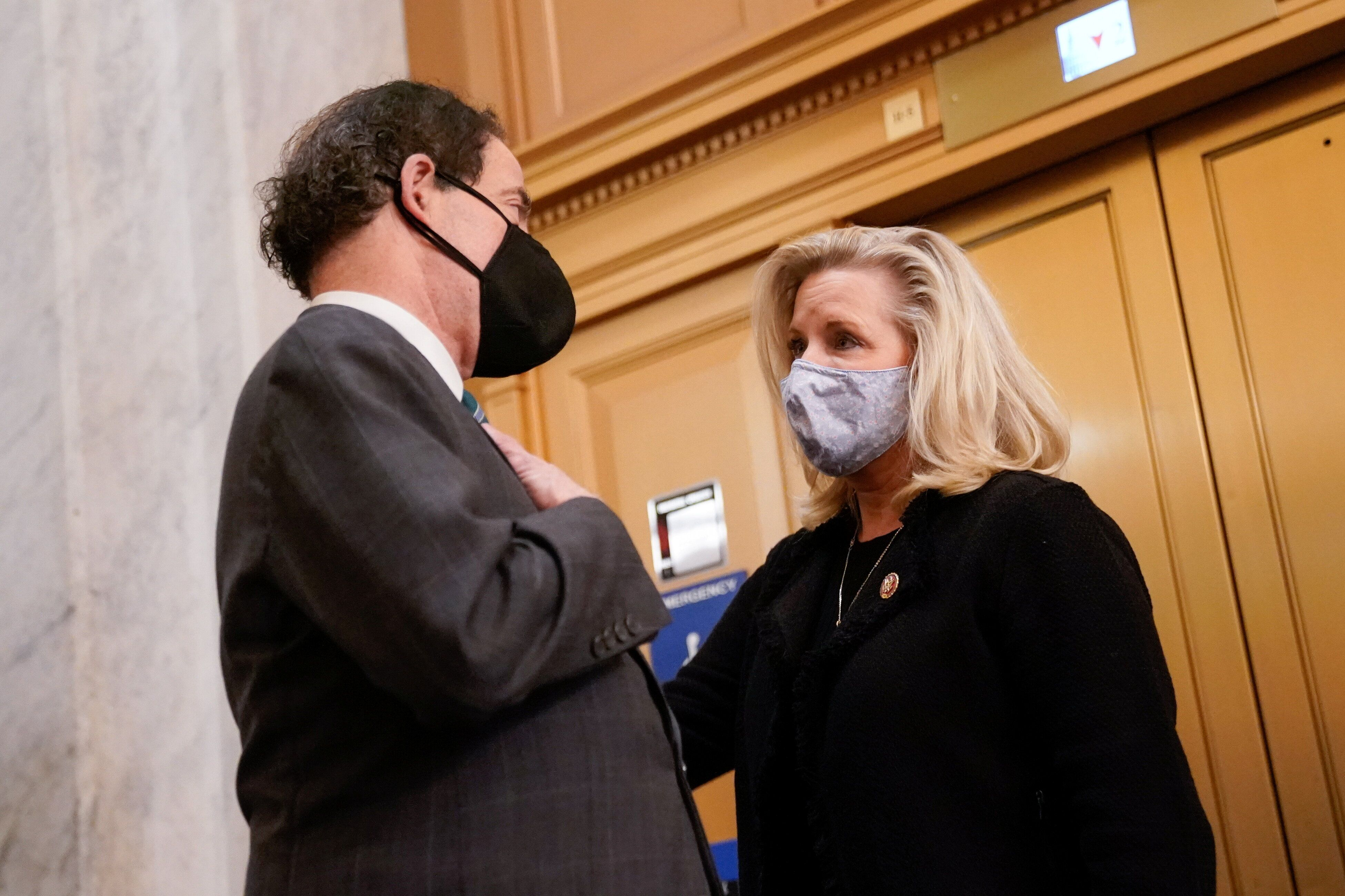 Rep. Jamie Raskin (D-MD) talks with Rep. Liz Cheney (R-WY) in the U.S. Capitol after the House voted on a resolution demandin