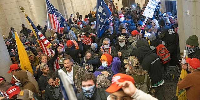 WASHINGTON, DC - JANUARY 06: Protesters supporting U.S. President Donald Trump gather near the east front door of the U.S. Capitol after groups breached the building's security on January 06, 2021 in Washington, DC. (Photo by Win McNamee/Getty Images)