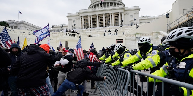 In this Jan. 6, 2021, file photo, Trump supporters try to break through a police barrier at the Capitol in Washington. For America's allies and rivals alike, the chaos unfolding during Donald Trump's final days as president is the logical result of four years of global instability brought on by the man who promised to change the way the world viewed the United States. (AP Photo/Julio Cortez, File)