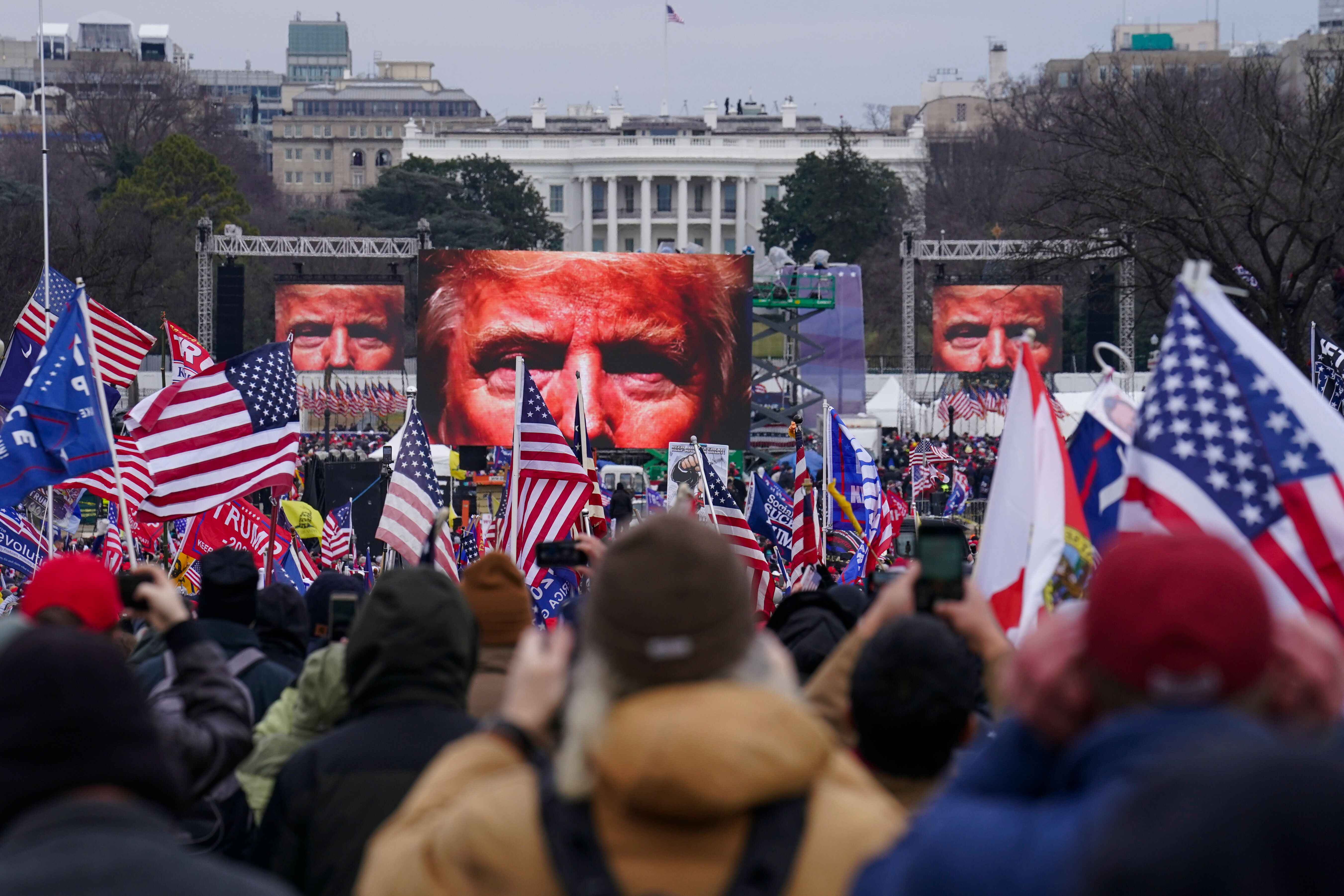 In this Jan. 6, 2021 file photo, Trump supporters participate in a rally in Washington. An AP review of records finds that me