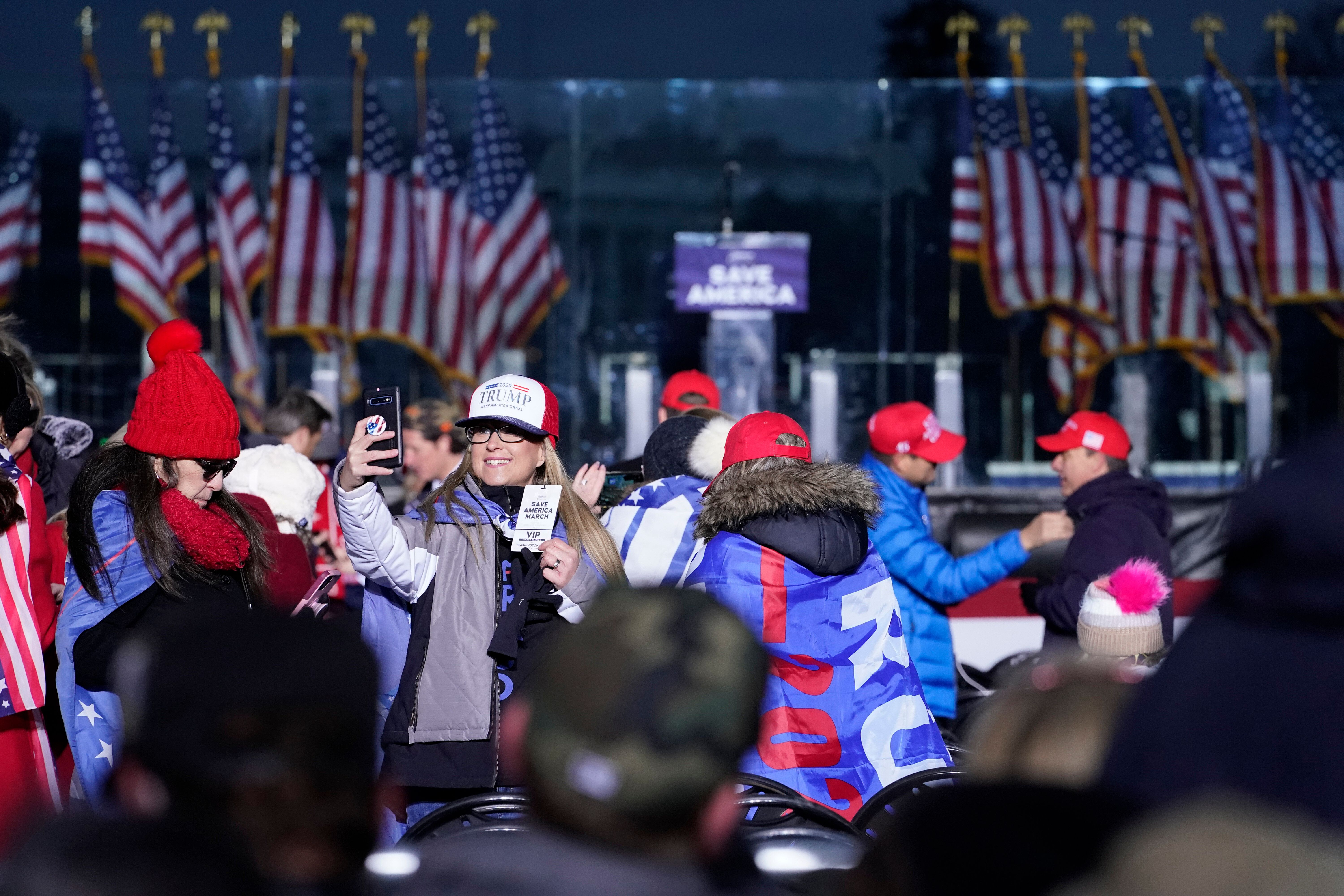 In this Jan. 6, 2021 file photo people arrive to attend a rally in support of President Donald Trump. An AP review of records