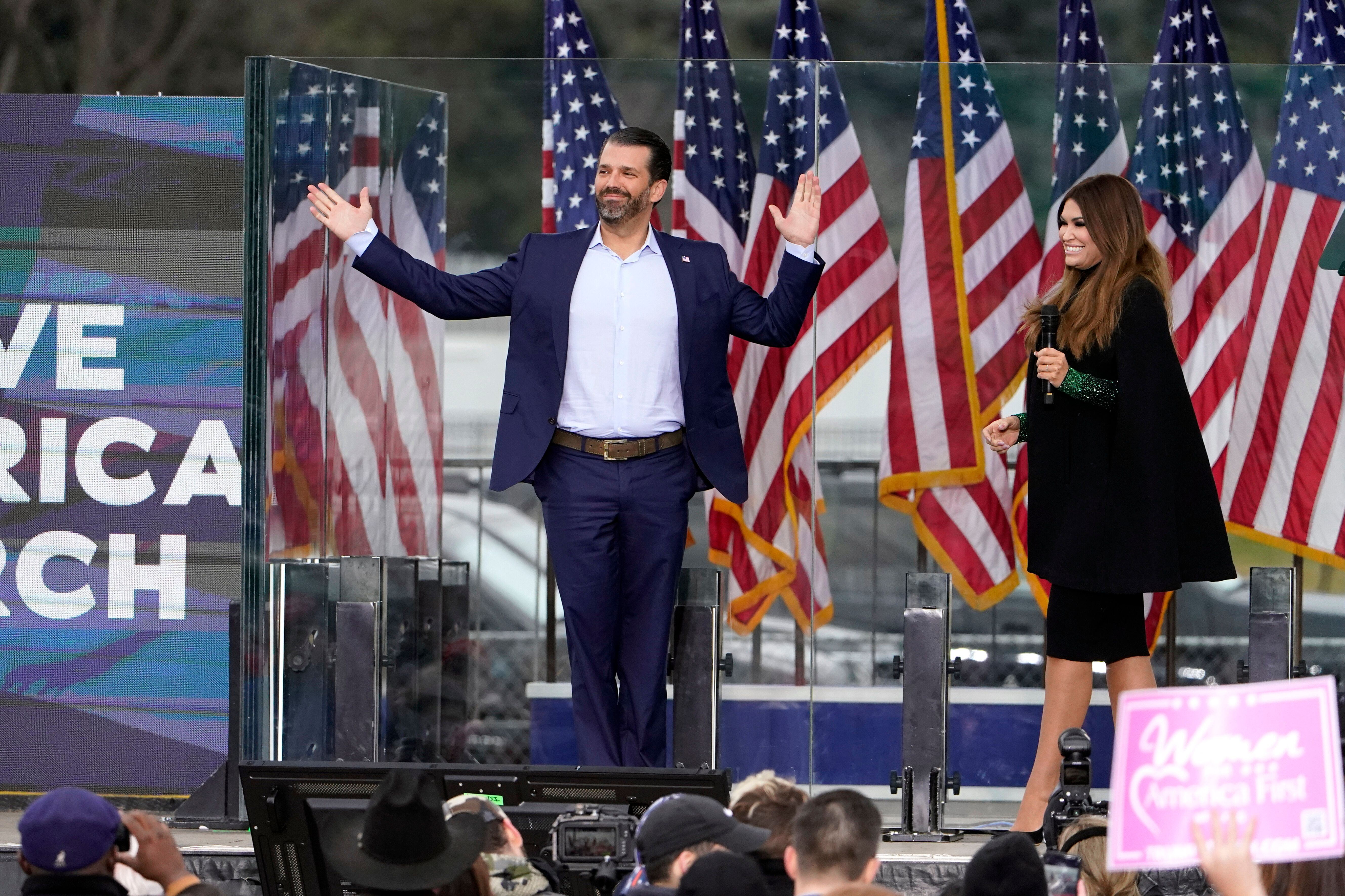 Donald Trump Jr. arrives on stage as Kimberly Guilfoyle speaks Wednesday, Jan. 6, 2021, in Washington, at a rally in support