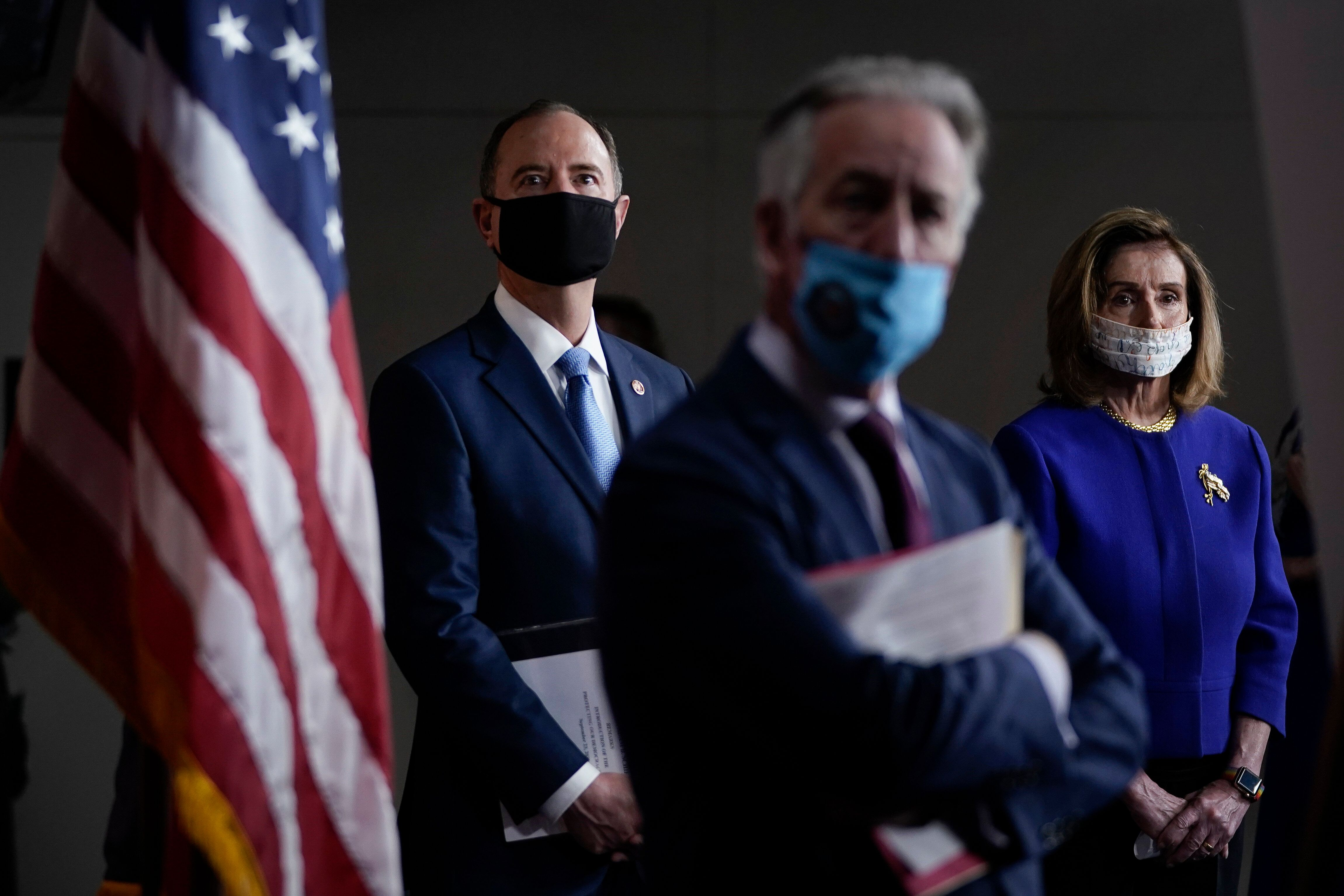 Rep. Adam Schiff (D-Calif.), Rep. Richard Neal (D-Mass.) and Speaker of the House Nancy Pelosi (D-Calif.) attend a news confe