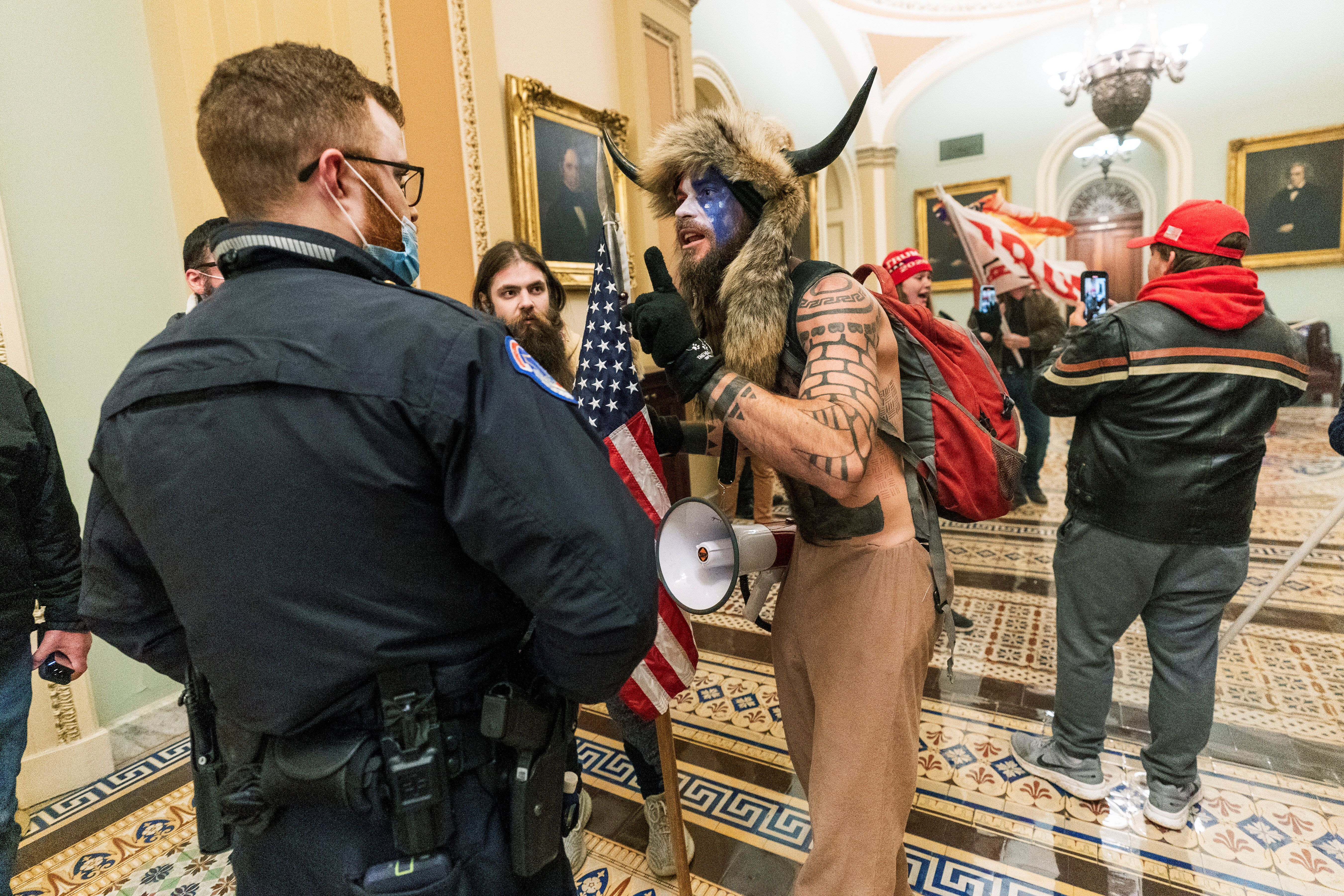 FILE - In this Jan. 6, 2021, file photo supporters of President Donald Trump are confronted by U.S. Capitol Police officers o