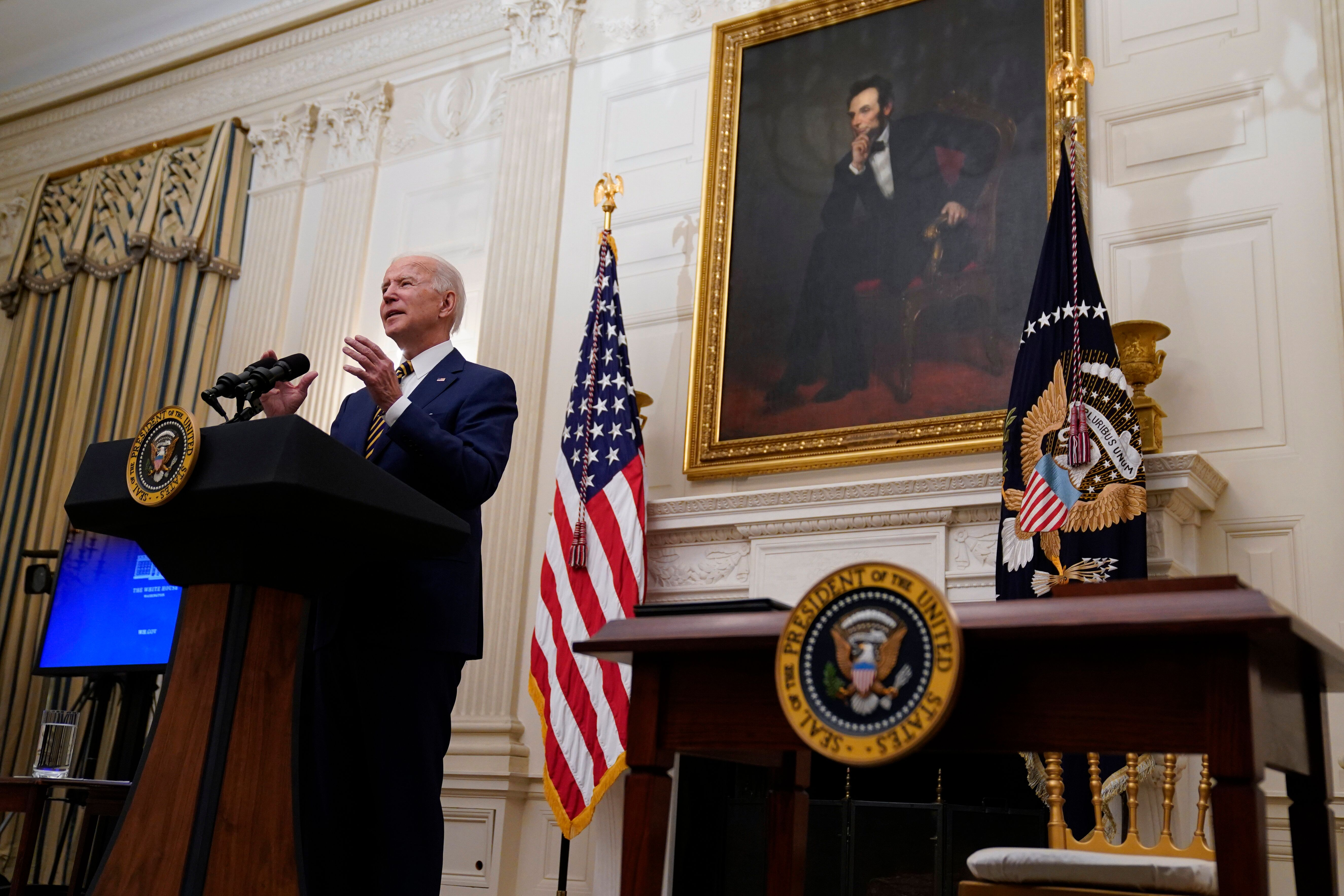President Joe Biden delivers remarks on the economy in the State Dining Room of the White House, Friday, Jan. 22, 2021, in Wa