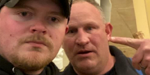 Police officers Jacob Fracker and Thomas Robertson took a selfie inside the U.S. Capitol during an insurrection. Fracker is a member of the National Guard, the Army said Friday.