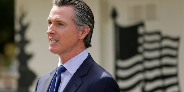 FILE: California Gov. Gavin Newsom speaks during a news conference at the Veterans Home of California in Yountville, Calif.