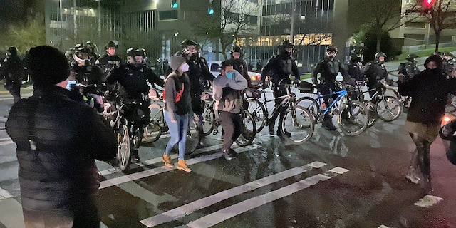 After a short standoff, the Tacoma Police advanced on the mob, ordering them to disperse. Not everyone took them seriously as some mocked them with a dance as they were pushed out of the intersection.