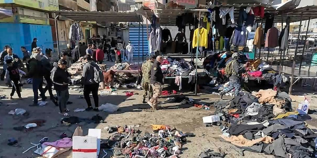 <br> People and security forces gather at the site of a deadly bomb attack in a market selling used clothes, in Baghdad, Iraq, Jan. 21, 2021. (Associated Press)