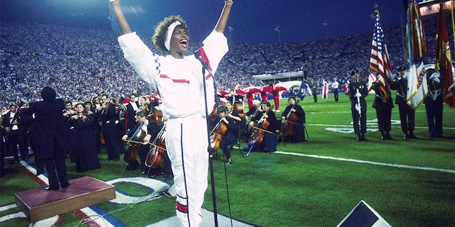 Whitney Houston's 1991 performance at Super Bowl XXV has been universally acclaimed. (Photo by Michael Zagaris/Getty Images)