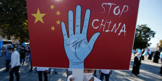 A protester from the Uighur community in Turkey holds an anti-China placard during a protest in Istanbul on Oct. 1, 2020, against what they allege is oppression by the Chinese government to Muslim Uighurs in the far-western Xinjiang province. (AP Photo/Emrah Gurel, File)