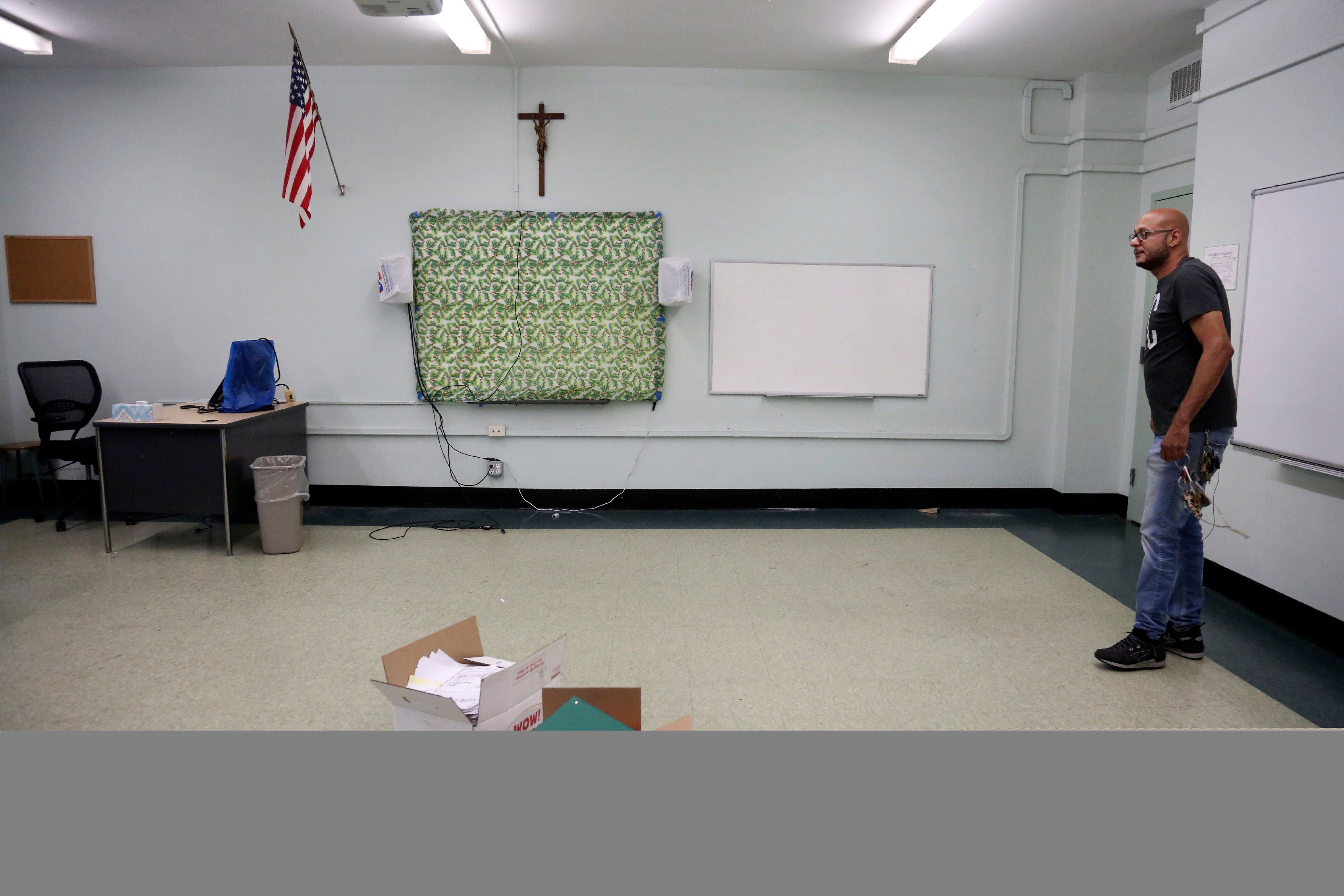 Facilities manager Charles Fabian stands in an empty classroom at Queen of the Rosary Catholic Academy in Brooklyn, New York,