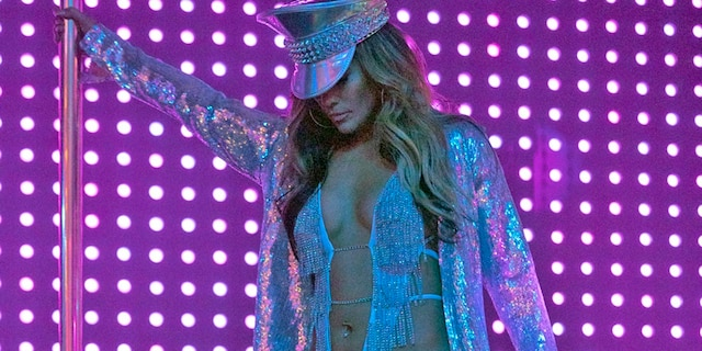 This image released by STXfilms shows Jennifer Lopez, in a scene from 'Hustlers.' Lopez stars as Ramona, a leader of strippers in a Robin Hood-esque scheme to steal from rich men.
