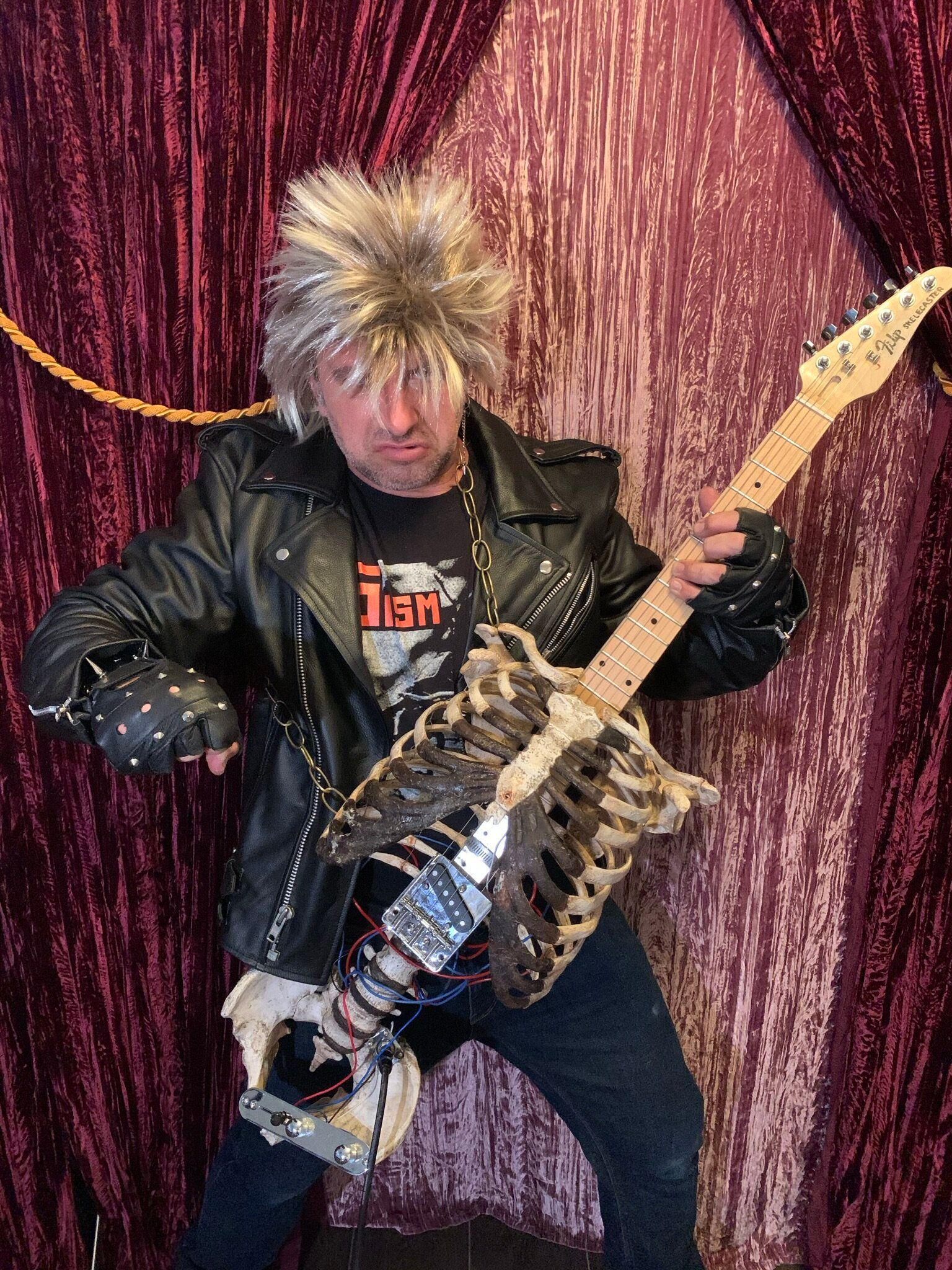 Florida-based musician Prince Midnight shows off his guitar made from his Uncle Filip's bones.