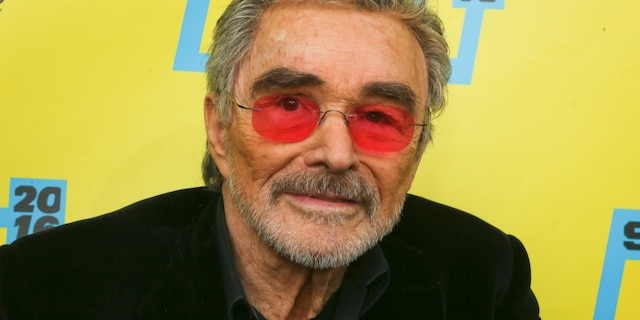 """Burt Reynolds, the legendary actor with the disarming smile and trademark mustache who starred in iconic films including """"Smokey and the Bandit"""" and """"The Longest Yard,"""" died in 2018 at age 82."""