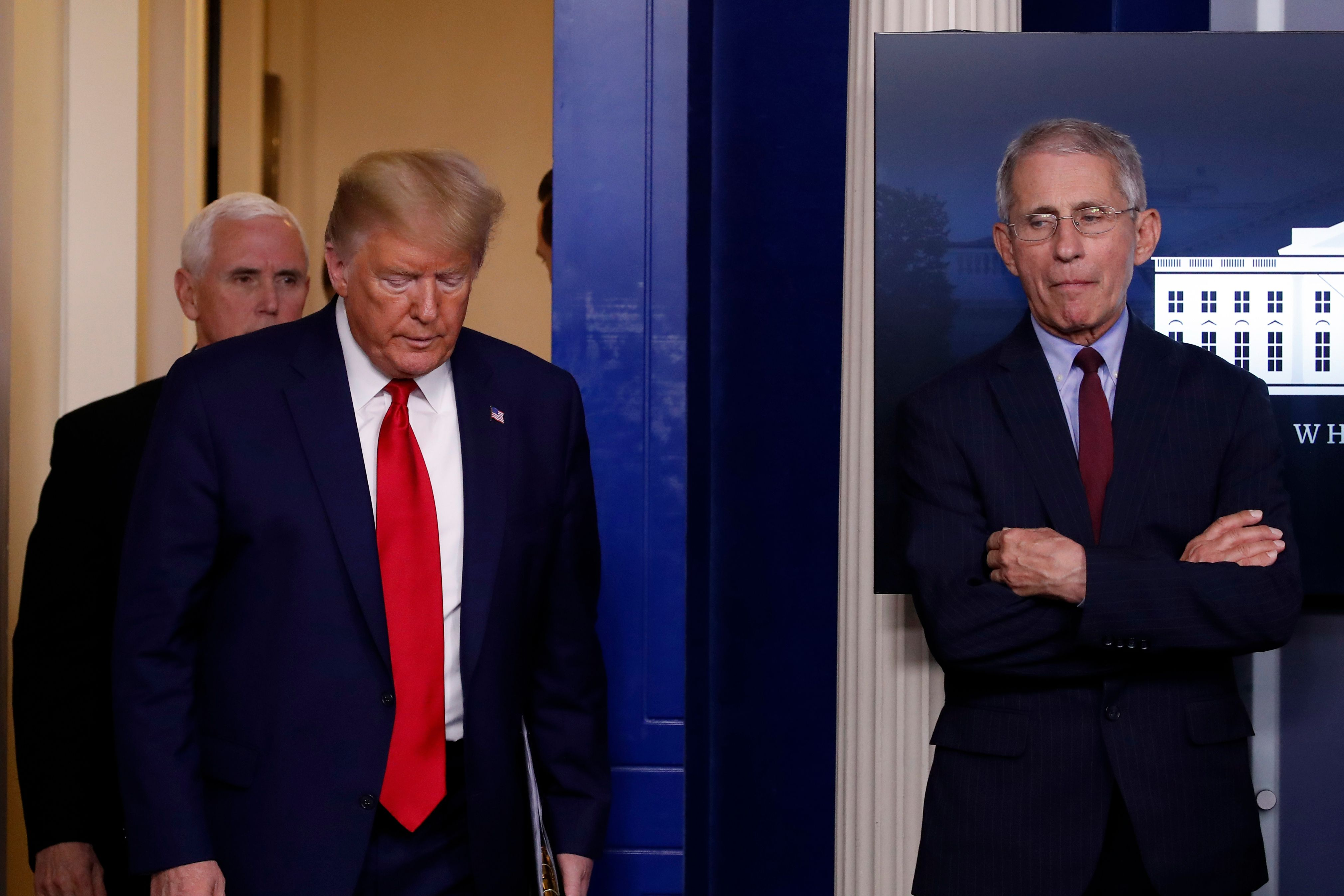Then-President Donald Trump arrives with his vice president, Mike Pence, to speak to the press about the coronavirus on March