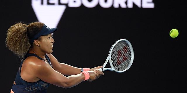 Japan's Naomi Osaka hits a backhand return to United States' Jennifer Brady during the women's singles final at the Australian Open tennis championship in Melbourne, Australia, Saturday, Feb. 20, 2021.(Associated Press)