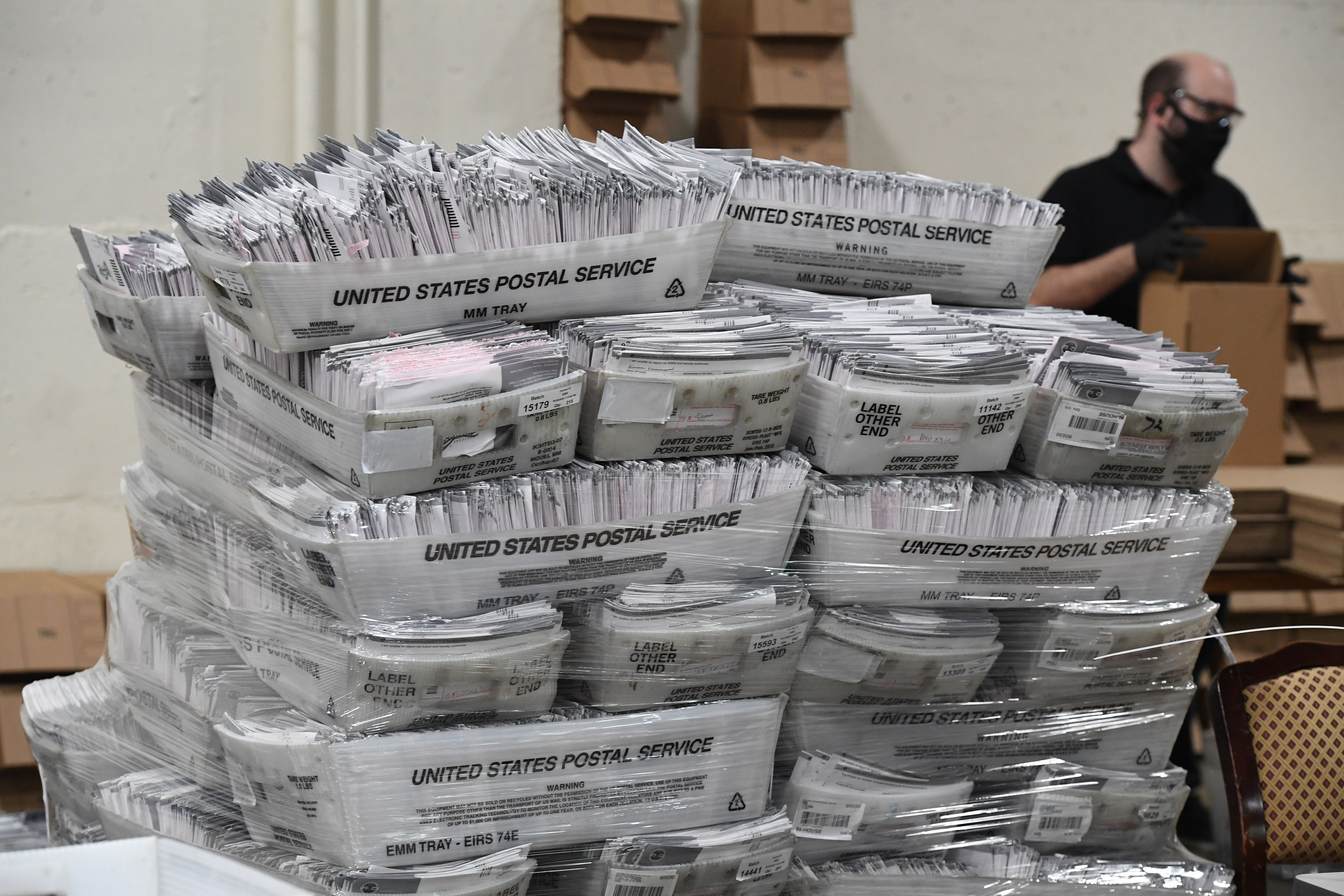 Mail-in ballots in their envelopes await processing at the Los Angeles County Registrar Recorders' mail-in ballot processing
