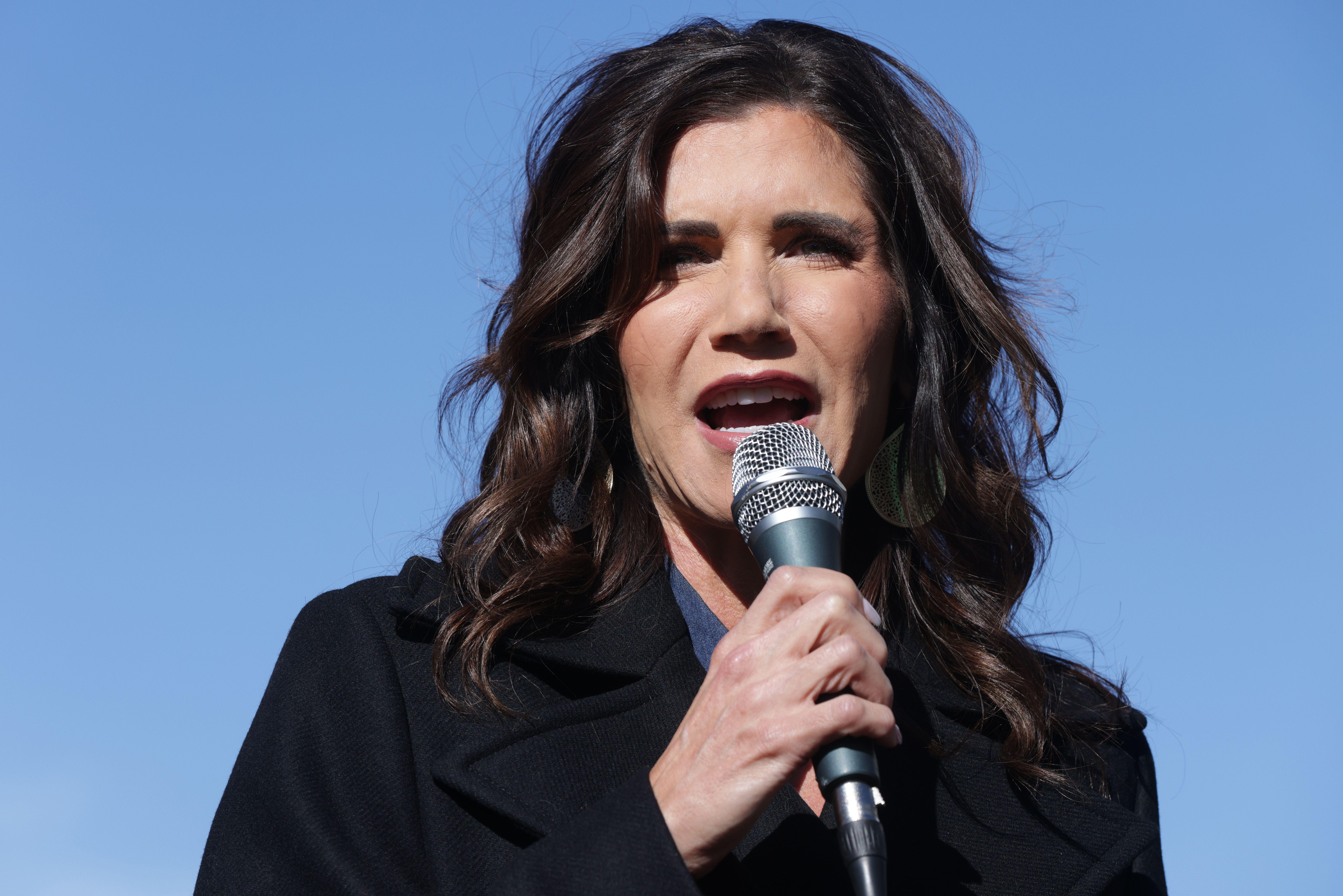 South Dakota Gov. Kristi Noem campaigns for then-Sen. Kelly Loeffler (R-Ga.) outside the Gritz Family Restaurant on Jan. 3, 2