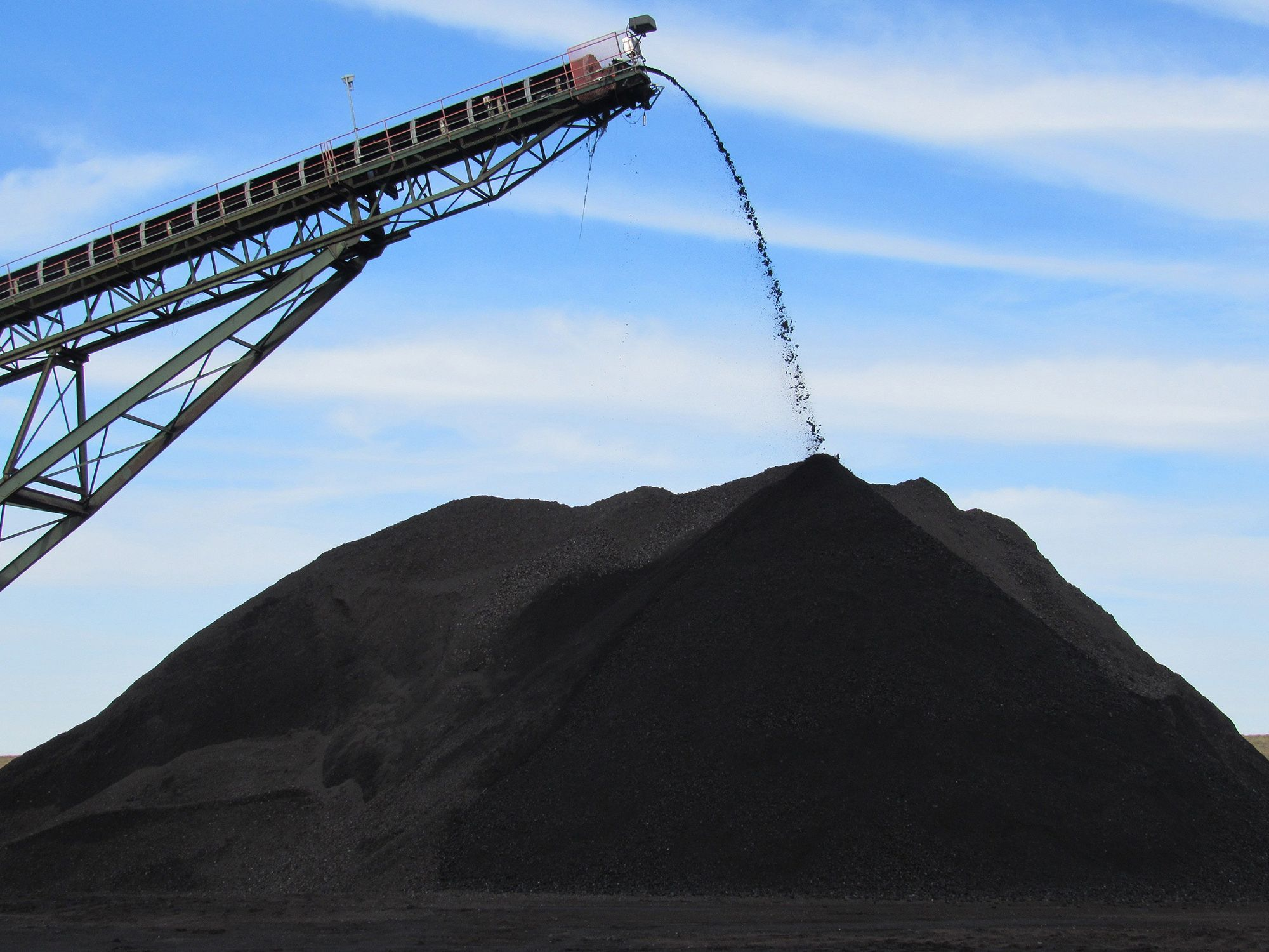 Coal from an underground mine in Muhlenberg County, Kentucky, pours off the end of a conveyor onto a pile used to load trucks