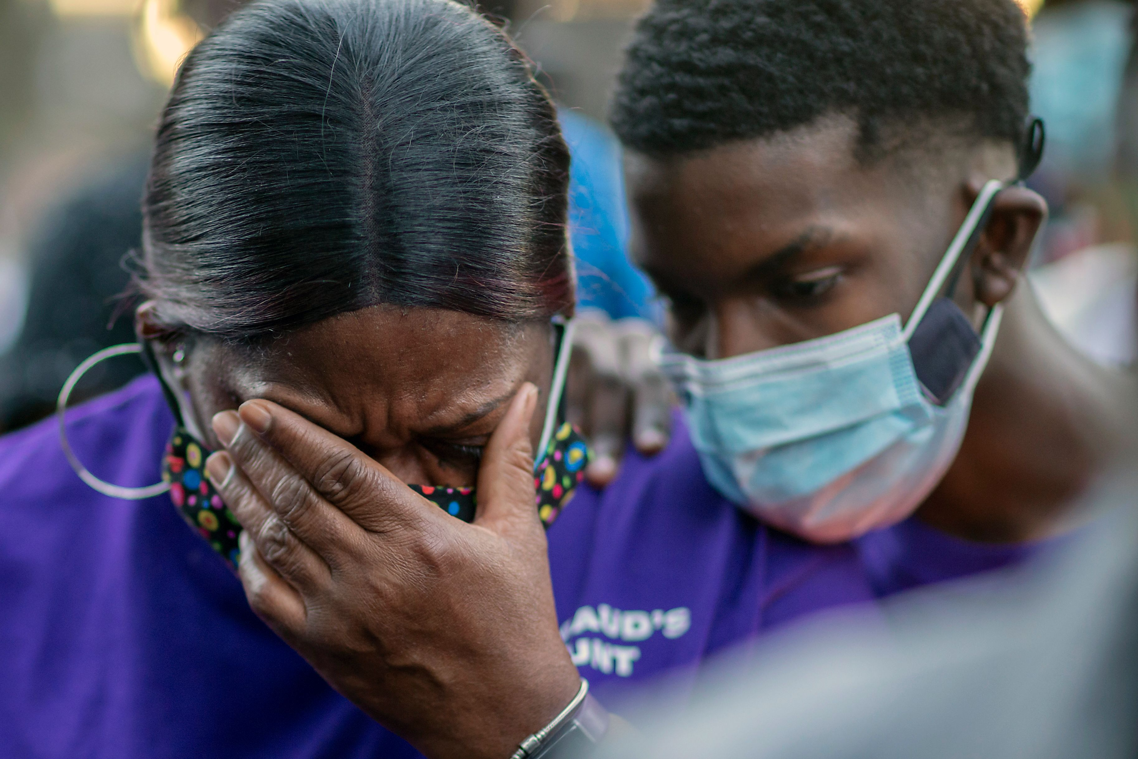Evon Arbery, Ahmaud Arbery's aunt, is comforted by a family member during Tuesday's memorial walk and candlelight vigil.&nbsp