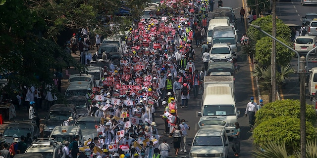 Anti-coup protesters march in Yangon, Burma, on Thursday. (AP Photo)