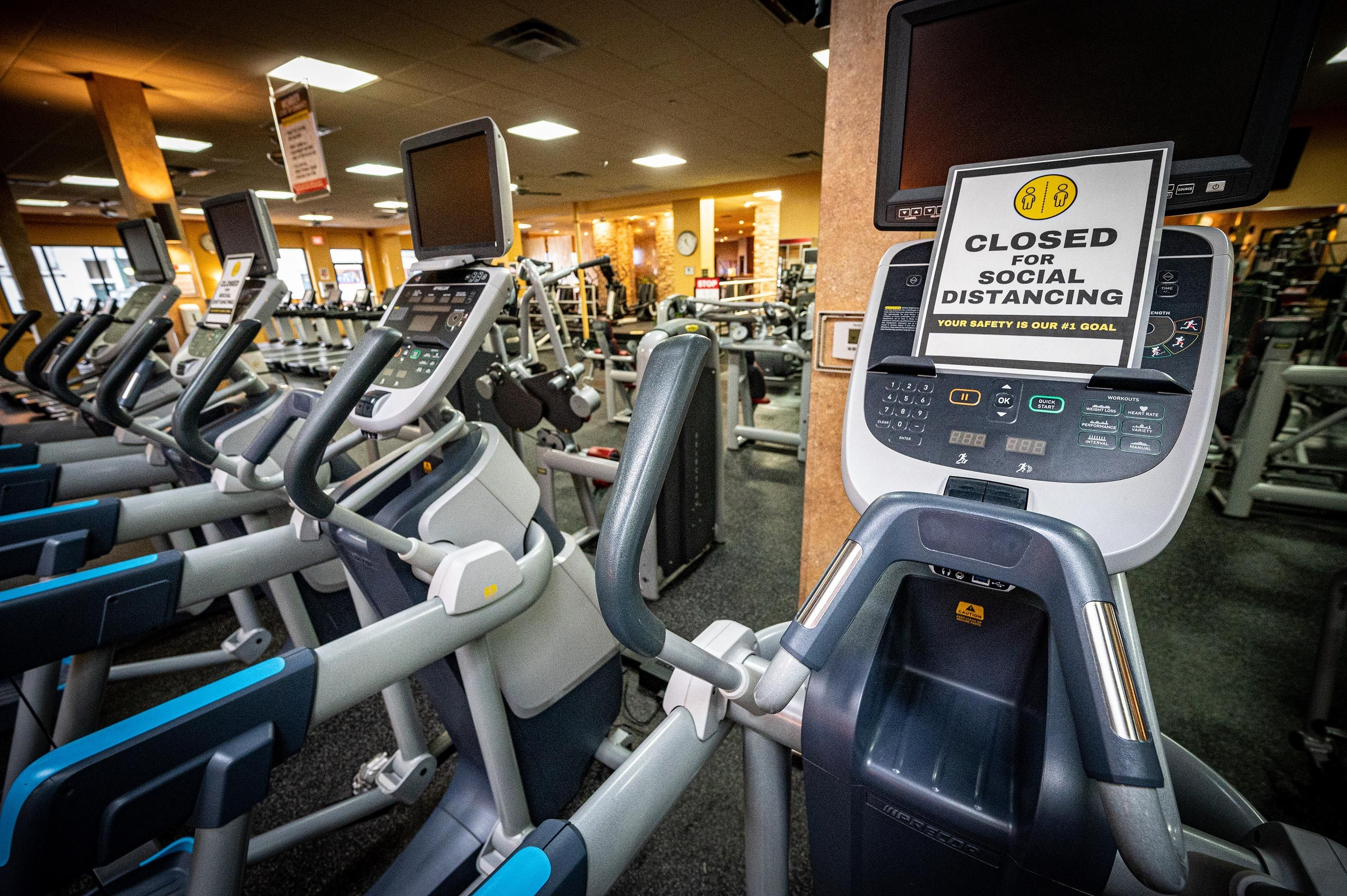 Social distancing signs on machines at Gold's Gym in East Northport, New York, on Aug. 19, 2020, ahead of reopening after the