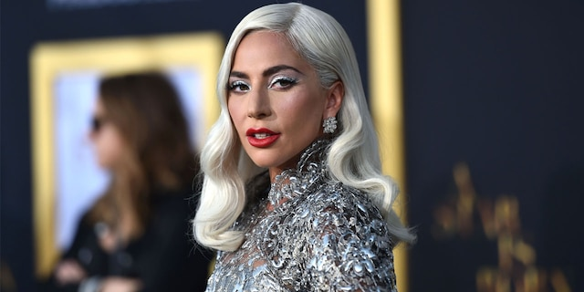 Lady Gaga has been in contact with her dog walker, who remains hospitalized in Los Angeles after being shot by an armed robber on Wednesday. The pop star remains in Italy where she was when the incident took place.