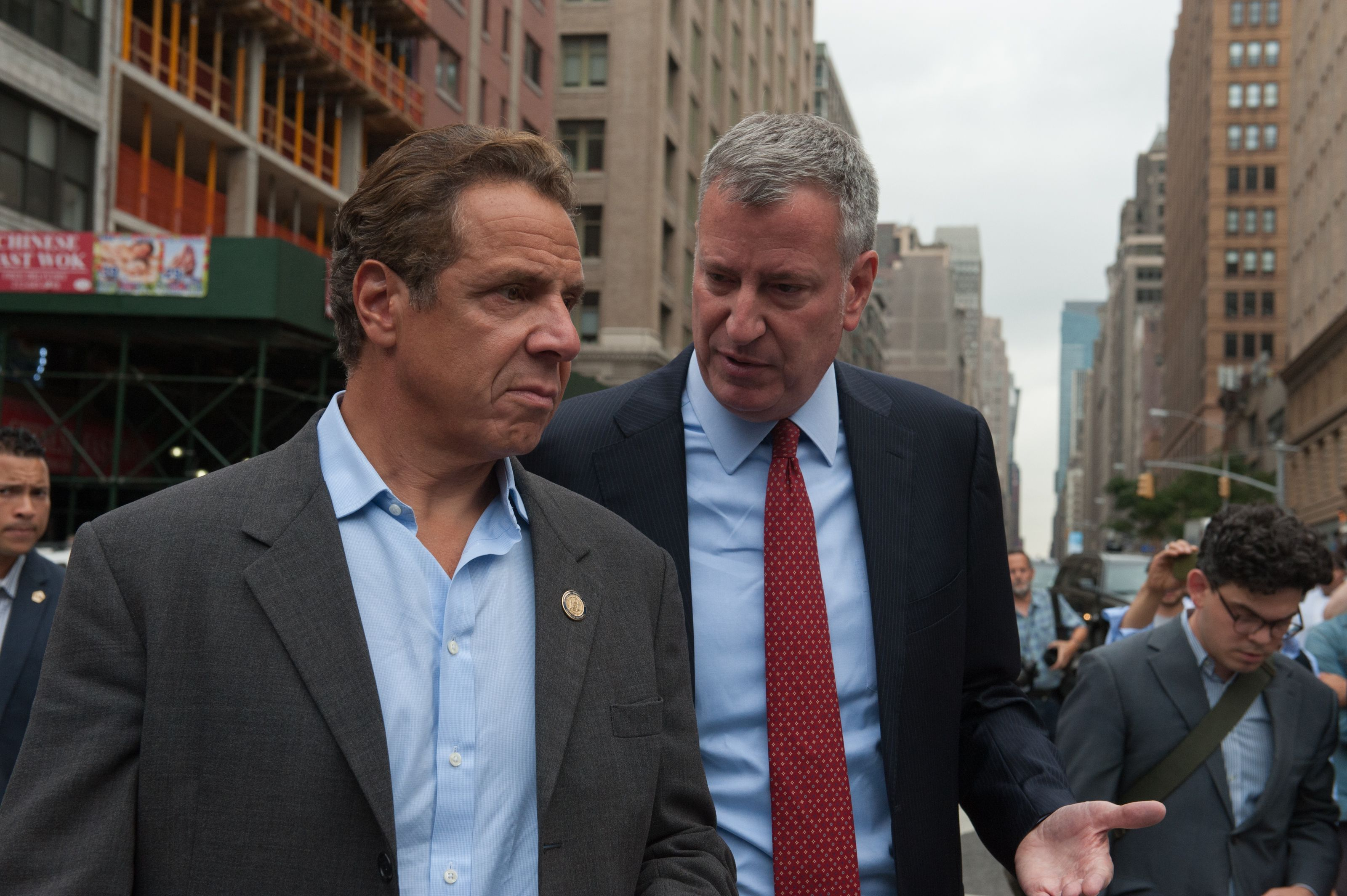 Squabbling at the beginning of the pandemic between Cuomo, left, and New York City Mayor Bill de Blasio, right, resulted in a