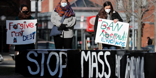 In this Wednesday, Jan. 13, 2021 file photo, Tenants' rights advocates demonstrate outside the JFK federal building in Boston. (AP Photo/Michael Dwyer)