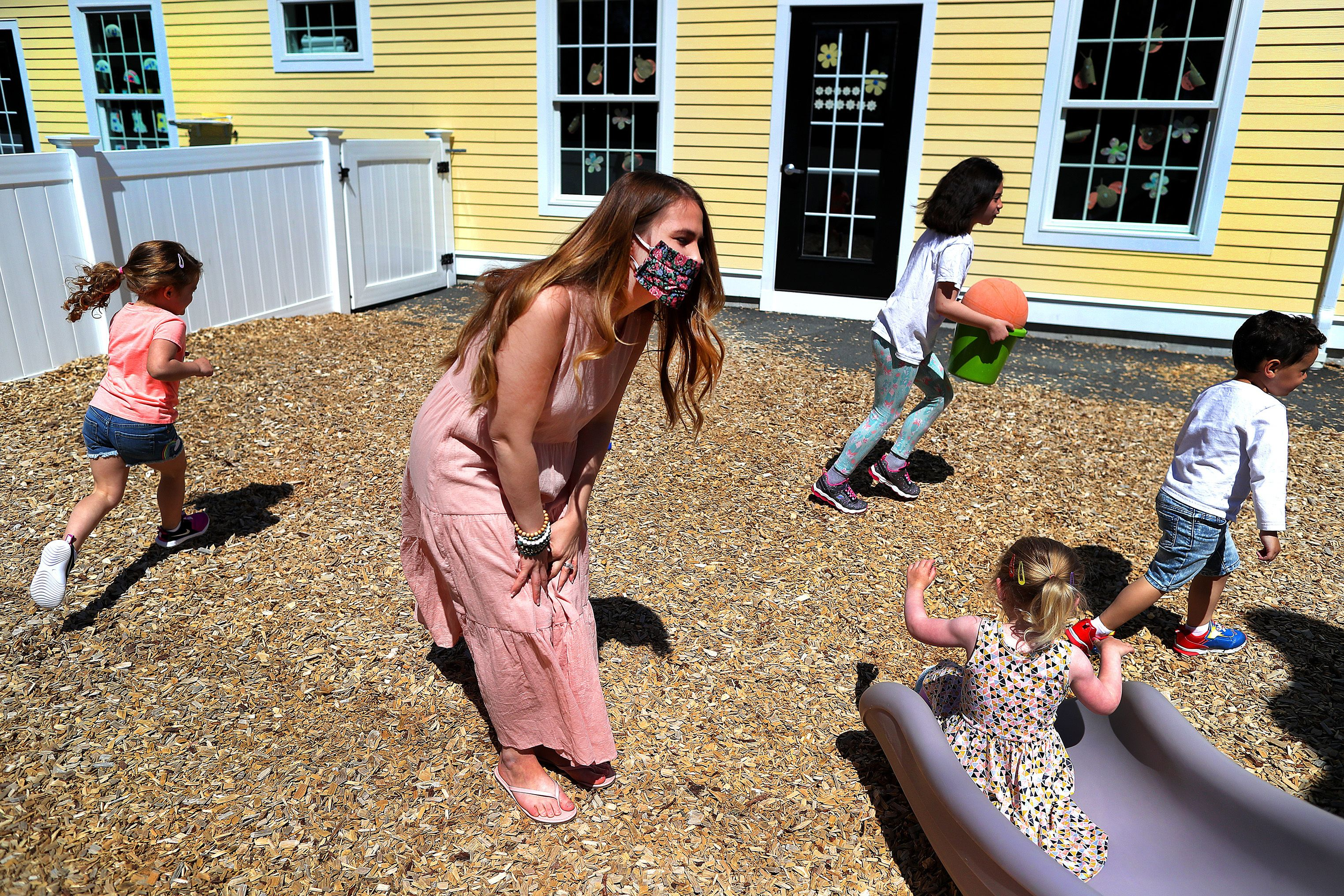 Preschool teacher Jenna Grenier keeps an eye on the children at Magical Beginnings Learning Academy in Middleton, Massachuset
