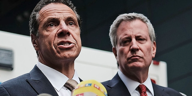 Governor of New York Andrew Cuomo stands with New York City Mayor Bill de Blasio at a news conference at the Time Warner Center after an explosive device was found this morning on October 24, 2018 in New York City. (Photo by Spencer Platt/Getty Images)