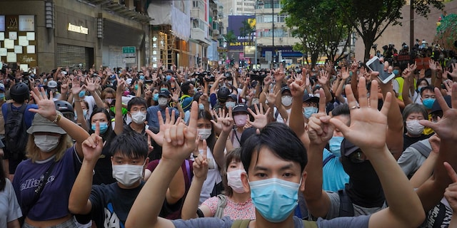 Protesters in Hong Kong, in July 2020, demonstrate on the anniversary of Hong Kong's handover to China from Britain. (AP)